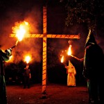 Members of the Ku Klux Klan participate in a cross lighting ceremony at a klansman's home, Saturday, Oct. 23, 2010, in Warrenville, S.C. KKK Imperial Wizard Duwayne Johnson said it was the first public cross lighting in 50 years.